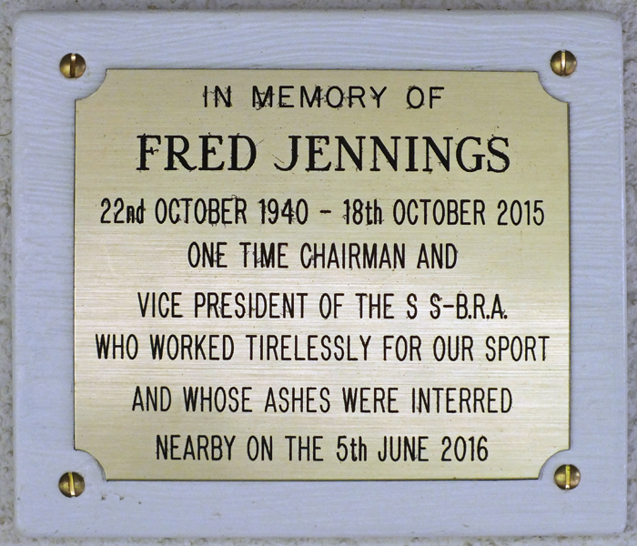 Photograph shows the plaque mounted on the clubhouse wall, dedicated to Fred Jennings, for his dedication to the sport of Smallbore Rifle Shooting.
