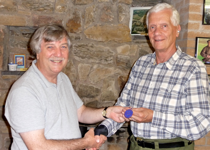 Photograph shows Osborn Spence - SSRA Airgun Secretary (left) presenting the SSRA Individual Air Rifle 'B' League - Summer 2019 - 3rd Place Medal to John Phillips of Leek (right).