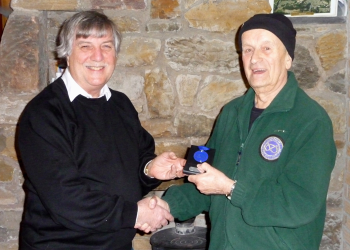 Photograph shows Osborn Spence - SSRA Airgun Secretary (pictured left) presenting the SSRA Individual Air Rifle 'B' League - Winter 2019/2020 - 2nd Place Medal to Alf Whiston of Leek and District Shooting Centre (pictured right).