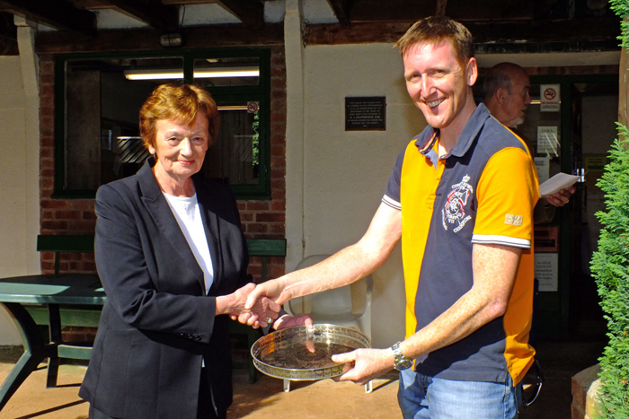 Photograph shows Mary Jennings, pictured left, presenting the Come Day - Go Day Salver to Simon Green, pictured right.