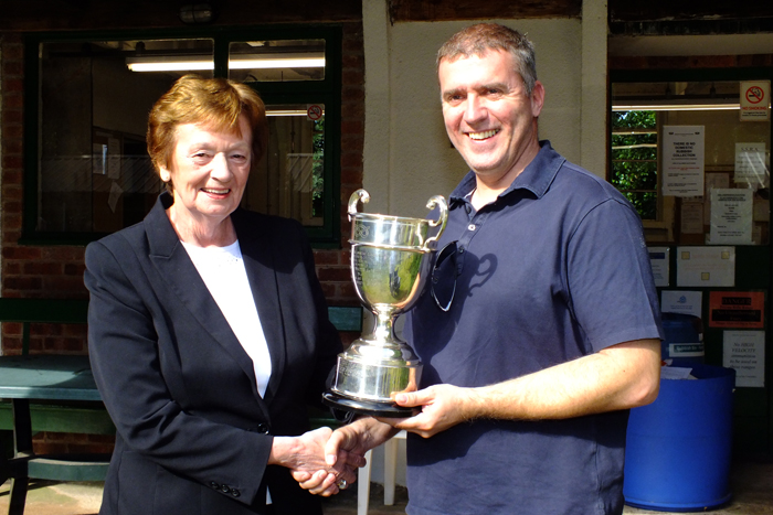 Photograph shows Mary Jennings, pictured left, presenting the R.W. De Nicolas Memorial Trophy to Stuart Powell, pictured right.