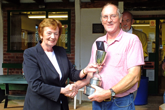 Photograph shows Mary Jennings, pictured left, presenting the Swynnerton Cup and Staffordshire Class 'B' Aggregate 1st Place Medal to Gordon Abbots, pictured right.