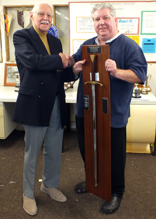 Photograph shows SSRA President - Major (Retired) Peter Martin MBE, pictured left - presenting the Wilkinson Sword to Paul D Barker, pictured right.